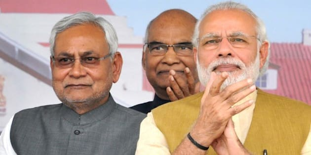 PATNA, INDIA - MARCH 12: Prime Minister Narendra Modi with Bihar Chief Minister Nitish Kumar during the Closing Ceremony of the Centenary Year Celebrations of the Patna High Court on March 12, 2016 in Patna, India. Modi said here that the 'quality of argument and judgement will improve with technology being used actively' in the courts. He also sought suggestions on making the bar, bench and courts tech-savvy by injecting digital technology in their functioning. (Photo by AP Dube/Hindustan Times via Getty Images)