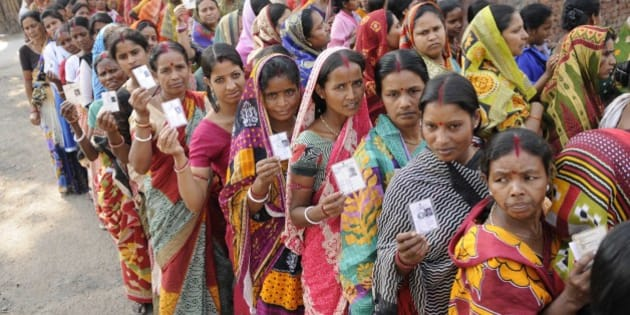 ASANSOL, INDIA - APRIL 11: People stand in a queue to cast their vote for West Bengal Assembly elections at Kendulia School, Jamuria on April 11, 2016 in Asansol, India. Amid sporadic incidents of clash and scorching heat, 79.56 per cent votes were cast on Monday in part two of the first phase of polling in 31 Assembly constituencies spread over three districts in West Bengal. (Photo by Samir Jana/Hindustan Times via Getty Images)
