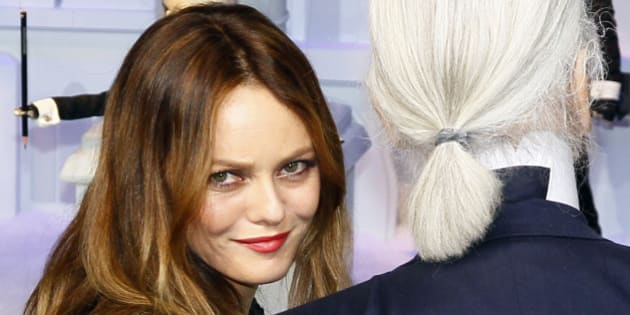 French actress and singer Vanessa Paradis, left, and fashion designer Karl Lagerfeld pose front of a Parisian department store unveiling its festive decorations in Paris, Wednesday, Nov. 9, 2011. (AP Photo/Francois Mori)