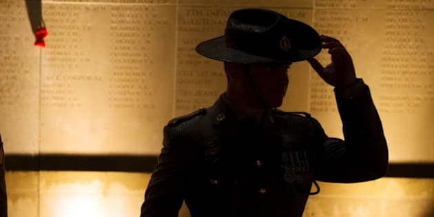 An Australian army soldier attends the dawn service to mark the 100th anniversary of ANZAC (Australian and New Zealand Army Corps) Day at the Australian National Memorial in Villers-Bretonneux, in northern France, April 25, 2015. The Gallipoli campaign has resonated through generations, which have mourned the thousands of soldiers from the ANZAC cut down by machinegun and artillery fire as they struggled ashore on a narrow beach. The fighting would eventually claim more than 130,000 lives, 87,000 of them on the side of the Ottoman Turks, who were allied with imperial Germany in World War One.  REUTERS/Philippe Wojazer