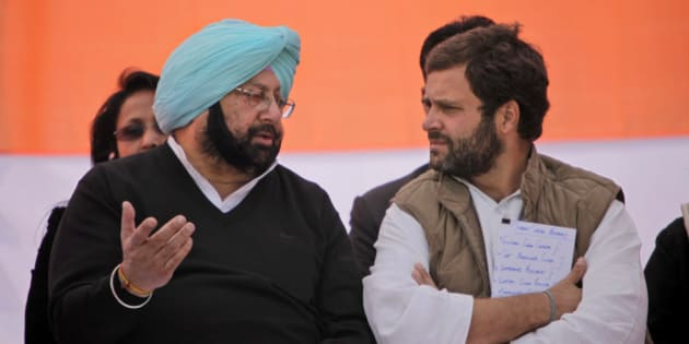 India's ruling Congress party leader Rahul Gandhi, right, speaks with former chief minister of Punjab state Captain Amarinder Singh during an election rally at in Chabal some 30 kilometers (19 miles) from Amritsar, India, Wednesday, Jan. 25, 2012. (AP Photo/Altaf Qadri)