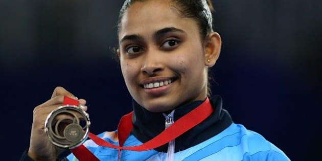 Dipa Karmakar of India poses with her medal after winning bronze in the womens vault final of the Artistic Gymnastics event during the 2014 Commonwealth Games in Glasgow, Scotland, on July 31, 2014. AFP PHOTO / CARL COURT        (Photo credit should read CARL COURT/AFP/Getty Images)