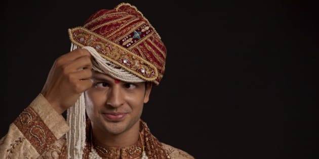 Gujarati groom with a headdress making a face