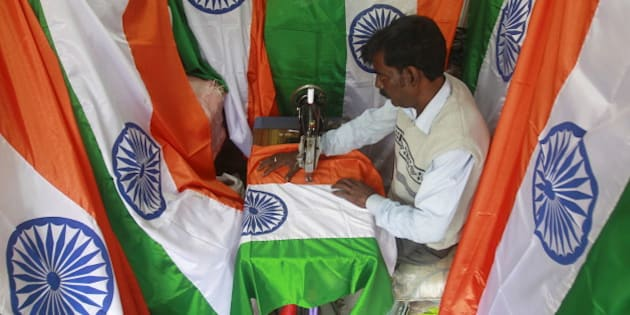 A tailor makes Indian national flags ahead of the Republic Day celebrations in Agartala, India, January 18, 2016. India celebrates its annual Republic Day on January 26. REUTERS/Jayanta Dey