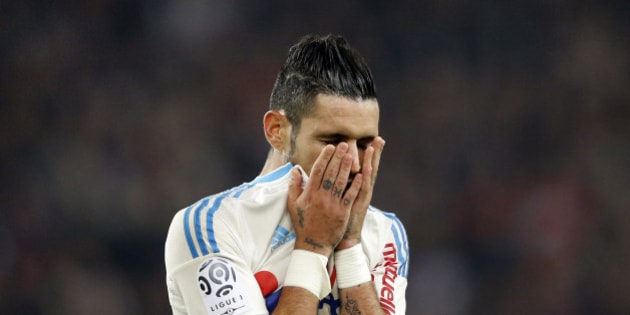 Olympique Marseille's Remy Cabella reacts at the end of his French Ligue 1 soccer match against Paris St Germain at the Parc des Princes stadium in Paris, France, October 4, 2015. REUTERS/Regis Duvignau
