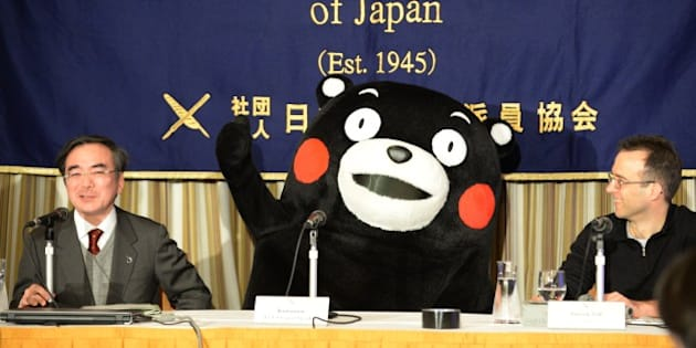Kumamon gestures during a press conference at the foreign correspondents' club in Tokyo on February 14, 2014. A life-size bear mascot with red cheeks and no voice held a press conference in Tokyo on February 14, the latest public relations coup for the rural Japanese region he represents.    AFP PHOTO / TOSHIFUMI KITAMURA        (Photo credit should read TOSHIFUMI KITAMURA/AFP/Getty Images)