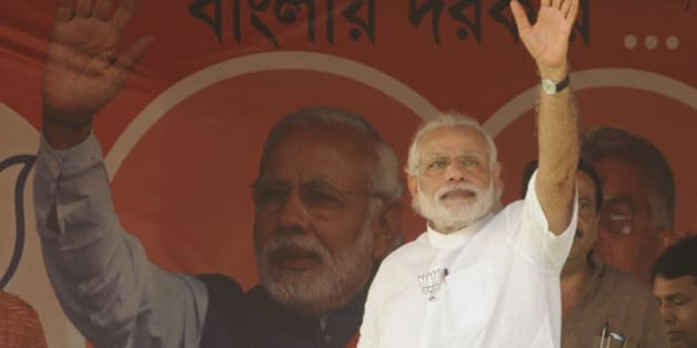 NADIA, INDIA - APRIL 17: Prime Minister Narendra Damodardas Modi wave hand to public during an election campaign rally before third phase of Assembly Election at Krishnanagar Govt. College ground, on April 17, 2016 in Nadia, India. (Photo by Samir Jana/Hindustan Times via Getty Images)