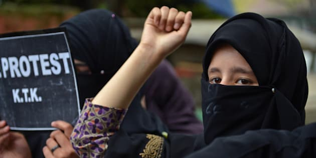 Activists from the Muslim Khawateen Markaz (MKM) take part in a protest in Srinagar on April 15, 2016 over the killing of four youths in Handwara.
