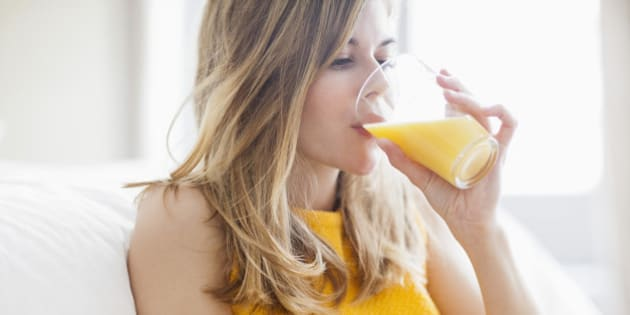 Woman drinking orange juice