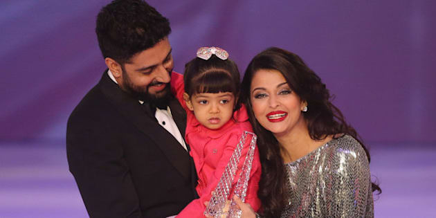 Former Miss World Aishwarya Rai, centre speaks on stage with husband Abhishek Bachchan and daughter Aaradhya Bachchan, during the Miss World 2014 final, on stage at the Excel centre in east London, Sunday, Dec. 14, 2014. (Photo by Joel Ryan/Invision/AP)