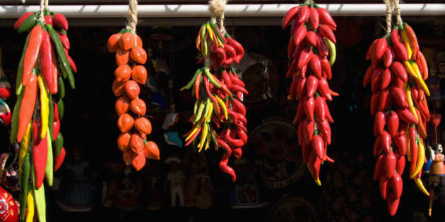 Close-up of strands of red chili peppers hanging,Olvera Street,Los Angeles,California,USA