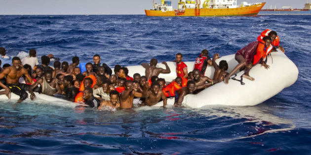 In this photo taken on Sunday, April 17, 2016 migrants ask for help from a dinghy boat as they are approached by the SOS Mediterranee's ship Aquarius, background, off the coast of the Italian island of Lampedusa. The European Union's border agency says the number of migrants crossing the Mediterranean Sea to Italy more than doubled last month. Frontex said in a statement on Monday that almost 9,600 migrants attempted the crossing, one of the most perilous sea voyages for people seeking sanctuary or jobs in Europe. (Patrick Bar/SOS Mediterranee via AP)