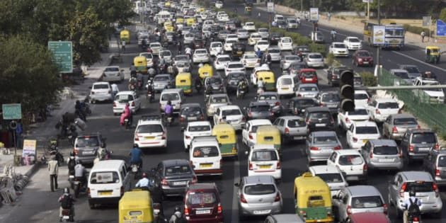 NEW DELHI, INDIA - APRIL 18: Slow traffic at NH-24 during the Odd-Even Plan on April 18, 2016 in New Delhi, India. Day four of the Delhi governments odd-even experiment began with reports of major traffic snarls emerging from various parts of the city. The second phase of the odd-even experiment was launched on April 15 to reduce the alarming levels of air pollution in the city.  (Photo by Ravi Choudhary/ Hindustan Times via Getty Images)