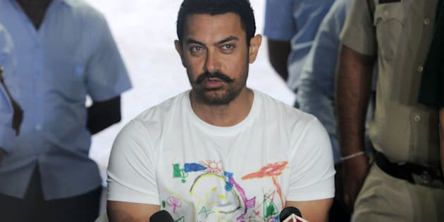 MUMBAI, INDIA MARCH 14:  Aamir Khan celebrates his 51th birthday with the media at his residence at Bandra in Mumbai.(Photo by Milind Shelte/India Today Group/Getty Images)