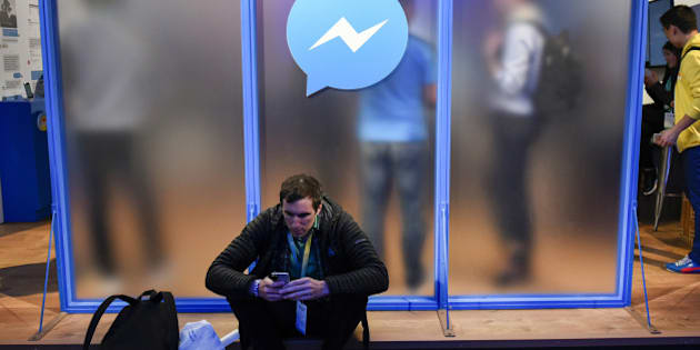 An attendee sits in front of a messenger logo during the Facebook F8 Developers Conference in San Francisco, California, U.S., on Tuesday, April 12, 2016. Facebook Inc. Chief Executive Officer Mark Zuckerberg outlined a 10-year plan to alter the way people interact with each other and the brands that keep advertising dollars rolling at the worlds largest social network. Photographer: Michael Short/Bloomberg via Getty Images