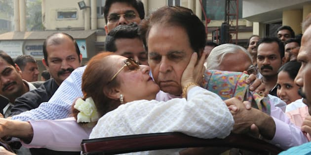 MUMBAI, INDIA - DECEMBER 11: Bollywood actor Dilip Kumar kissed by his wife, actress Saira Banu as he steps out of Lilavati Hospital to leave for his home on his 92nd birthday on December 11, 2014 in Mumbai, India. He was admitted last week for a chest infection. (Photo by Vijayanand Gupta/Hindustan Times via Getty Images)