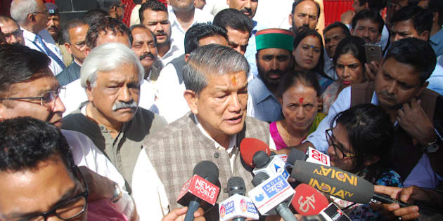 DEHRADUN, INDIA - MARCH 28: Former CM Harish Rawat with his MLAs and supporters coming out of the Governor's house on March 28, 2016 in Dehradun, India. Day after President's rule was imposed in Uttarakhand, Congress said it will approach all legal and constitutional forums against the injustice done to Harish Rawat government. (Photo by Vinay Santosh Kumar/Hindustan Times via Getty Images)