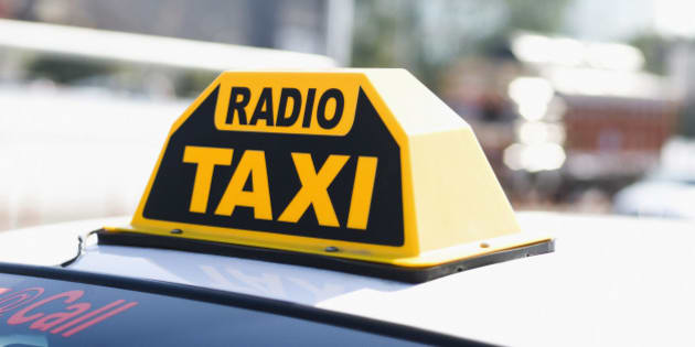 Close-up of a Radio Taxi sign on a taxi roof, Delhi, India