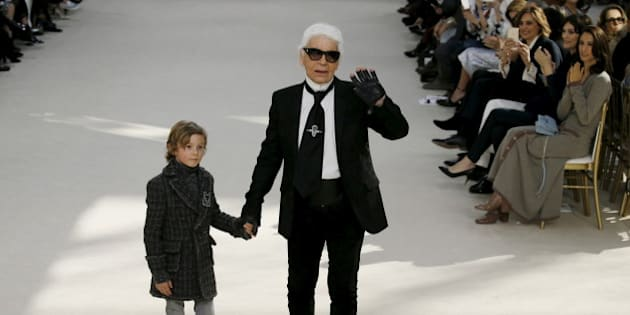 German designer Karl Lagerfeld and model Hudson Kroenig appear at the end of his Fall/Winter 2016/2017 women's ready-to-wear collection for fashion house Chanel at the Grand Palais in Paris, France, March 8, 2016. REUTERS/Gonzalo Fuentes      TPX IMAGES OF THE DAY