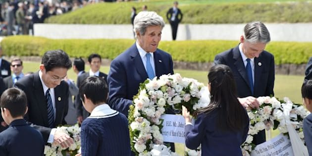US Secretary of State John Kerry (C), Japan's Foreign Minister Fumio Kishida (R) and British Foreign Secretary Philip Hammond receive wreaths to offer at the Memorial Cenotaph for the 1945 atomic bombing victims in the Peace Memorial Park, on the sidelines of the G7 Foreign Ministers' Meeting in Hiroshima on April 11, 2016. Kerry and other G7 foreign ministers made the landmark visit on April 11 to the memorial site for the world's first nuclear attack in Hiroshima.   / AFP / POOL / Kazuhiro NOGI        (Photo credit should read KAZUHIRO NOGI/AFP/Getty Images)