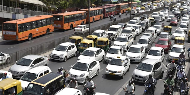 NEW DELHI, INDIA - APRIL 18: Traffic moving at Vikas Marg near PHQ on the first working day of second leg of Odd-Even on April 18, 2016 in New Delhi, India. Day four of the Delhi governments odd-even experiment began with reports of major traffic snarls emerging from various parts of the city. The second phase of the odd-even experiment was launched on April 15 to reduce the alarming levels of air pollution in the city.  (Photo by Virendra Singh Gosain/Hindustan Times via Getty Images)