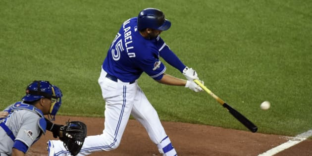 Oct 21, 2015; Toronto, Ontario, CAN; Toronto Blue Jays first baseman Chris Colabello (15) hits a home run during the second inning against the Kansas City Royals in game five of the ALCS at Rogers Centre. Mandatory Credit: Dan Hamilton-USA TODAY Sports