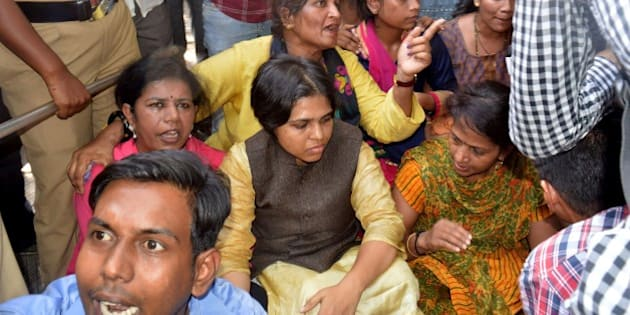 Indian activists including Trupti Desai(C)gather as they attempt to enter The Shani Shingnapur Temple in Ahmednagar, some 200kms east of Mumbai on April 2, 2016.  