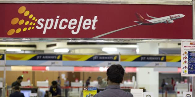 A traveler waits in front of a SpiceJet Ltd. ticket counter at Netaji Subhash Chandra Bose Domestic Airport in Kolkata, India, on Friday, April 8, 2011. Travel is surging in India, where the economy is estimated by the government to grow 9.25 percent in the current fiscal year, the fastest since the 12 months ended March 2008. Photographer: Brent Lewin/Bloomberg via Getty Images