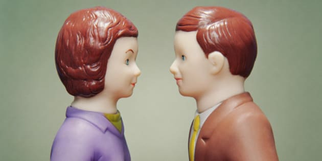 Husband and wife figurines facing each other
