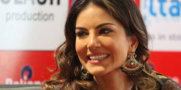 Film star Sunny Leone smiles during a press conference supporting her upcoming movie 'Shootout At Wadala' in Ahmadabad, India, Friday, April 26, 2013. The film based on growth of organized crime in late 70's and early 80's of Mumbai, will be released on May 3, according to a press release. (AP Photo/Ajit Solanki)