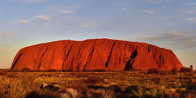 The sun sets at Uluru (Ayer's Rock) in the Northern Territory, Australia PRESS ASSOCIATION Photo. Picture date: Monday April 21, 2014. Photo credit should read: Anthony Devlin/PA Wire