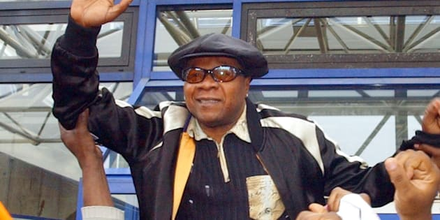 Congolese pop star Papa Wemba is hoisted by supporters as he leaves the courthouse in Bobigny near Paris Tuesday, Nov. 16, 2004, after he was sentenced to a 30-month term, with all but four suspended, for his involvment with an illegal immigration network. (AP Photo/Remy de la Mauviniere)