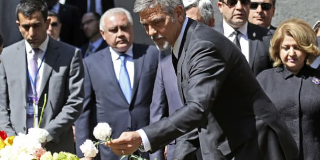 US actor George Clooney, foreground, puts a flower, as he attends a ceremony at a memorial to Armenians killed by the Ottoman Turks, in Yerevan, Armenia on Sunday, April 24, 2016. The killing of more than 200 Armenian intellectuals on April 24, 1915 is regarded as the start of the massacre that is widely viewed by historians as genocide. But modern Turkey, the successor to the Ottoman Empire, vehemently rejects the charge. Clooney has been a prominent voice in favor of countries recognizing the killings as genocide, which the United States has not done. (Vahan Stepanyan/ PAN Photo via AP)