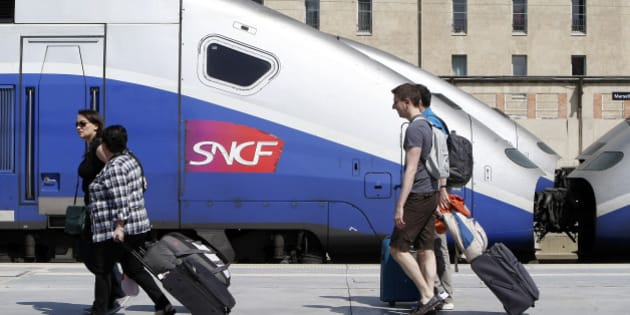 Passengers walk along a platform to take a train at the Gare St-Charles station in Marseille, southern France, Monday June 16, 2014. Workers of the French national railway SNCF are striking over plans to streamline and open the state-run network, considered among the world's best, to private competition. (AP Photo/Claude Paris)