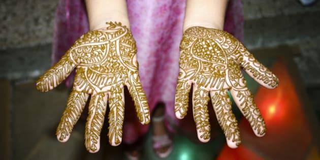Indian Girl showing her Heena Tattoo