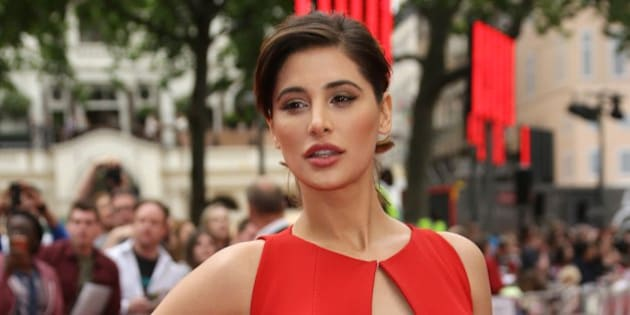 Nargis Fakhri poses for photographers upon arrival for the European premiere of Spy at the Odeon West End in central London, Wednesday, May 27, 2015. (Photo by Joel Ryan/Invision/AP)