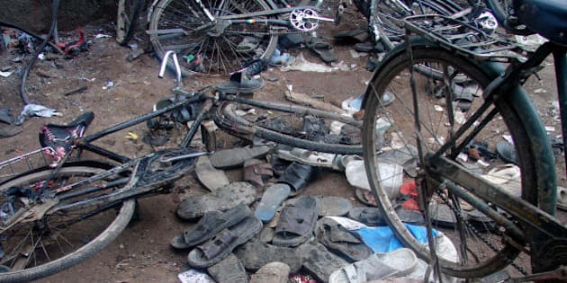 Malegaon, INDIA:  Piles of discarded shoes and fallen bicycles litter a street outside a mosque in Malegaon,some 260kms north of Mumbai, 08 September 2006, after a series of bomb blasts.   At least 37 people were killed and 50 others injured Friday in separate blasts in the western Indian town, officials said.The blasts occurred at Malegaon's Nurani mosque where devotees were offering Friday prayers.   AFP PHOTO/Courtesy of SAKAL  (Photo credit should read STRDEL/AFP/Getty Images)