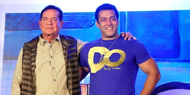 Indian Bollywood actor Salman Khan (R) and screenwriter Salim Khan pose for a photograph during a promotional event for the Hindi film 'Bajrangi Bhaijaan' directed by Kabir Khan in Mumbai on July 16, 2015. AFP PHOTO / STR        (Photo credit should read STRDEL/AFP/Getty Images)