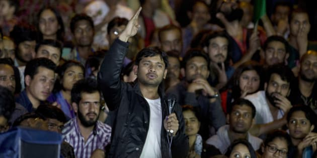 Jawaharlal Nehru University student union leader Kanhaiya Kumar makes a speech to fellow students after being released on bail at the university campus, in New Delhi, India, Thursday, March 3, 2016. Kanhaiya was facing sedition charges following protests where anti-India slogans were allegedly shouted. (AP Photo /Tsering Topgyal)