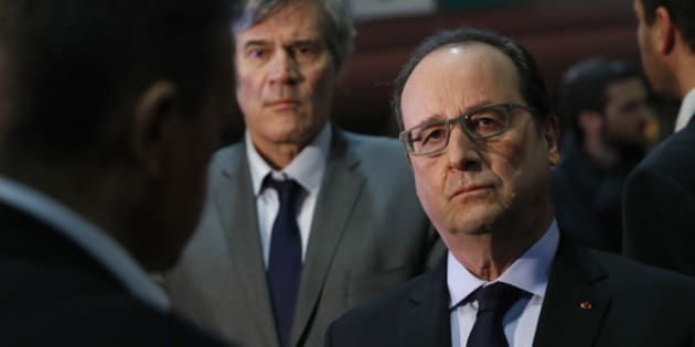 French President Francois Hollande and Agriculture Minister Stephane Le Foll, background, visit the Agriculture Fair, in Paris, on February 27, 2016. (Benoit Tessier/Pool Photo via AP)