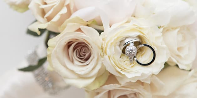 Close-up of Rings in Bouquet of Roses, Studio Shot