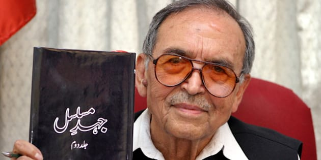 """Amanullah Khan, chief of the Jammu and Kashmir Liberation Front (JKLF), holds his autobiography """"Continuous Struggle"""" during an interview with Reuters in Rawalpindi June 17, 2005. The Pakistan-based Kashmiri separatist leader has for the first time revealed Pakistan's involvement in launching an insurgency in Indian-administered Kashmir in the late 1980s."""