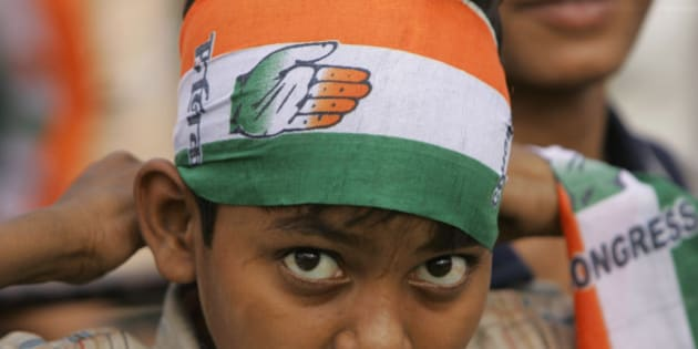 A young supporter of India's ruling Congress party  wears a scarf with party symbol, during an election rally in New Delhi, India, Sunday, May 3, 2009. (AP Photo/Gurinder Osan)