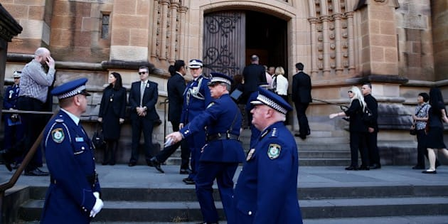 SYDNEY, AUSTRALIA - OCTOBER 17: People arrive for a funeral service for Curtis Cheng at St Mary's Cathedral October 17, 2015 in Sydney, Australia. Police employee, Curtis Cheng, was shot outside the NSW police headquarters in Parramatta two weeks ago by an Iranian born Australian. Australian Prime Minister Malcolm Turnbull has called the murder an 'act of terrorism.' (Photo by Tim Hunter.-Pool/Getty Images)