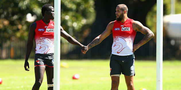 SYDNEY, AUSTRALIA - MARCH 11:  Aliir Aliir and  Lance Franklin of the Swans look on during a Sydney Swans AFL training session at Lakeside Oval on March 11, 2014 in Sydney, Australia.  (Photo by Ryan Pierse/Getty Images)