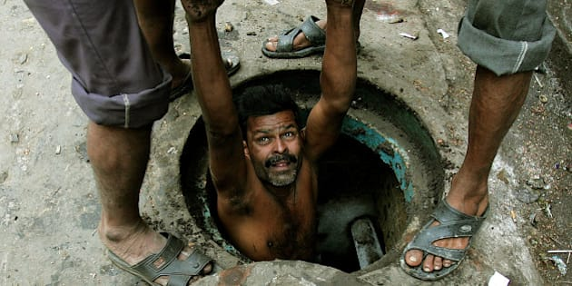 An Indian labourer is lowered to clean a sewage hole in the eastern Indian city of Kolkata December 16, 2005. Acceleration in economic growth has made India amongst the 10 fastest growing developing countries. Yet, about 30 percent of India's more than one billion people live below the official poverty line of 2,100-2,400 calories a day. REUTERS/Parth Sanyal