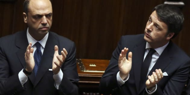Italian Prime Minister Matteo Renzi (R) applauds with Interior Minister Angelino Alfano, at the end of a speech by Italy's new President Sergio Mattarella, at the lower house of parliament in Rome, February 3, 2015. REUTERS/Alessandro Bianchi  (ITALY  - Tags: POLITICS)