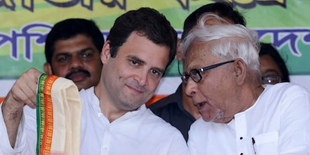 Congress vice-president Rahul Gandhi (L) and veteran Communist leader and former West Bengal chief minister Buddhadeb Bhattacharjee talk onstage during a joint rally between Congress and the Left Front political party in Kolkata on April 27, 2016.  