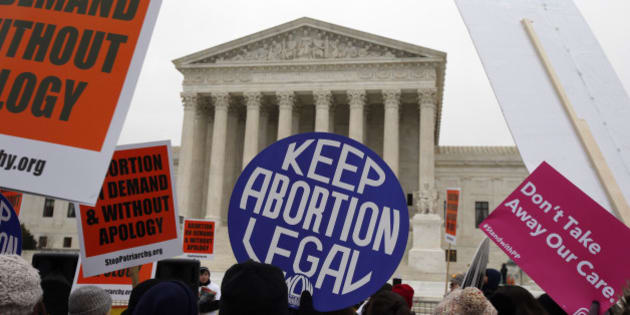 Pro-abortion rights signs are seen during the March for Life 2016, in front of the U.S. Supreme Court,  Friday, Jan. 22, 2016 in Washington, during the annual rally on the anniversary of 1973 'Roe v. Wade' U.S. Supreme Court decision legalizing abortion. (AP Photo/Alex Brandon)