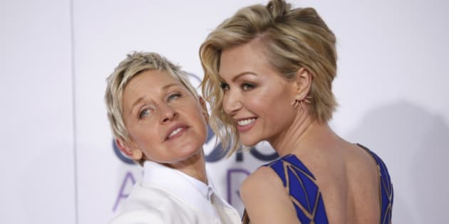 TV personality Ellen DeGeneres arrives with her spouse, actress Portia di Rossi (R), at the 2015 People's Choice Awards in Los Angeles, California January 7, 2015.   REUTERS/Danny Moloshok (UNITED STATES  - Tags: ENTERTAINMENT)  (PEOPLESCHOICE-ARRIVALS)